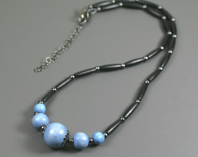 Light blue wood and black bone hairpipe necklace with gunmetal accents