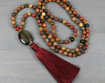 Red creek jasper, rainbow obsidian, and rainbow sheen obsidian hand knotted mala in the Tibetan style with a silk tassel