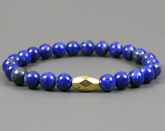 Lapis lazuli stacking stretch bracelet with an antiqued gold plated faceted double cone focal bead