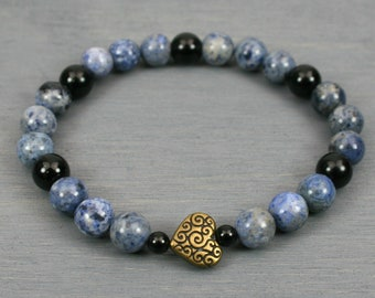 Flower dumortierite and obsidian stacking stretch bracelet with an antiqued brass plated heart scroll bead