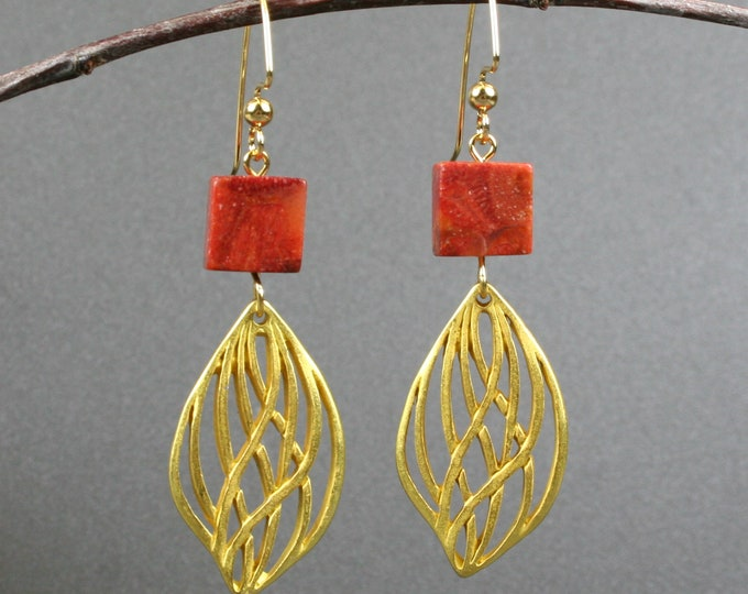 Gold finished open leaf dangle earrings with red coral on gold plated ear wires