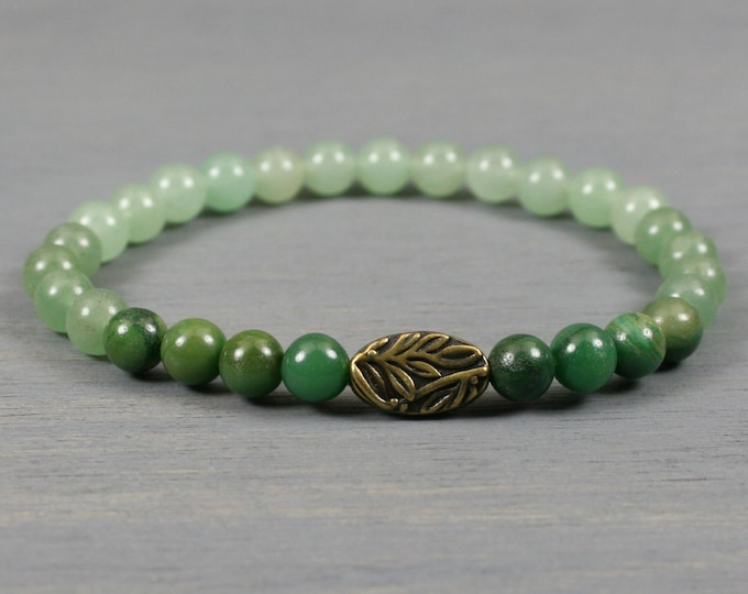 Ombre green aventurine stacking stretch bracelet with antiqued brass botanical focal bead