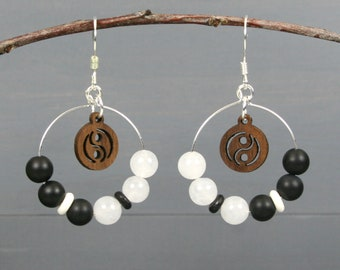 Black and white yin yang earrings with wood, black onyx, snow quartz, and black & white bone on silver plated ear wires