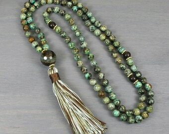 African turquoise, buri root, and cracked agate hand knotted mala in the Tibetan style with a silk tassel