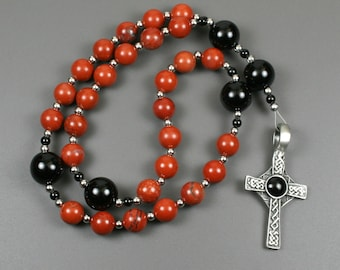 Anglican rosary in red jasper and black onyx with a antiqued pewter Celtic cross with a black resin inset