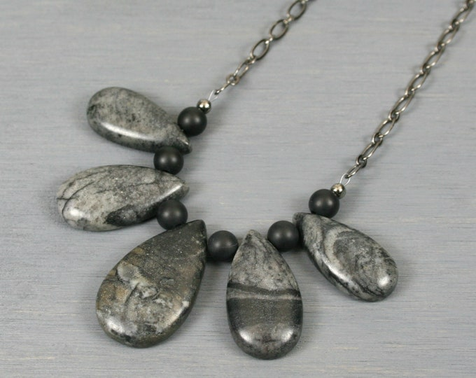 Picasso jasper teardrop fan necklace with matte black onyx on a gunmetal plated chain