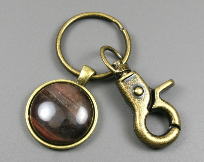 Red tiger eye key chain in an antiqued brass setting with swivel lobster claw