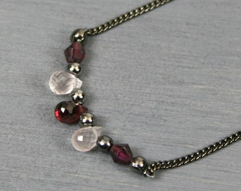 Garnet and rose quartz briolette necklace with garnet and gunmetal accents on gunmetal plated chain
