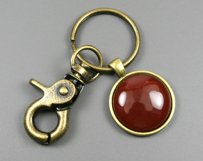 Carnelian key chain in an antiqued brass setting with swivel lobster claw