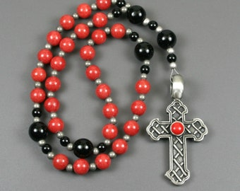 Anglican rosary in coral dolomite and obsidian with a antiqued pewter Celtic cross with a red resin inset