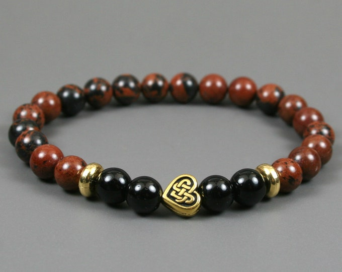 Mahogany obsidian and obsidian stacking stretch bracelet with an antiqued gold plated Celtic knot heart focal bead and gold plated spacers