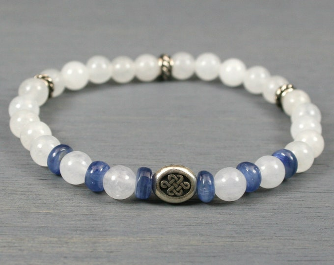 Blue kyanite and snow quartz stretch bracelet with an antiqued silver Celtic knot focal and antiqued silver roundels