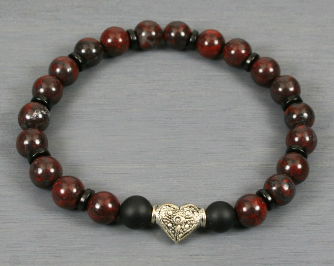Brecciated jasper stacking stretch bracelet with an antiqued silver plated heart, matte black onyx, and black coconut wood