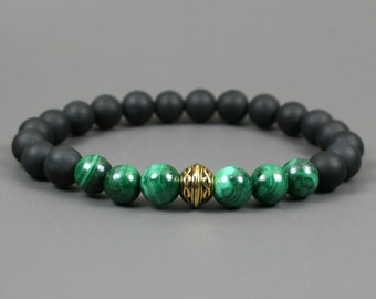 Malachite and matte black onyx stacking stretch bracelet with antiqued gold Celtic knot focal bead