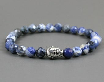 Faceted sodalite stacking stretch bracelet with an antiqued silver plated Buddha head focal bead