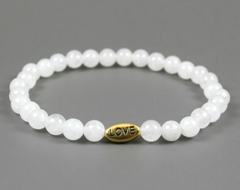 Snow quartz stretch bracelet with antiqued gold plated pewter LOVE bead, love bracelet, snow quartz bracelet, white bracelet
