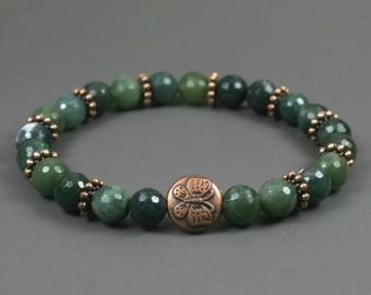 Moss agate stretch bracelet with antiqued copper plated butterfly accent bead