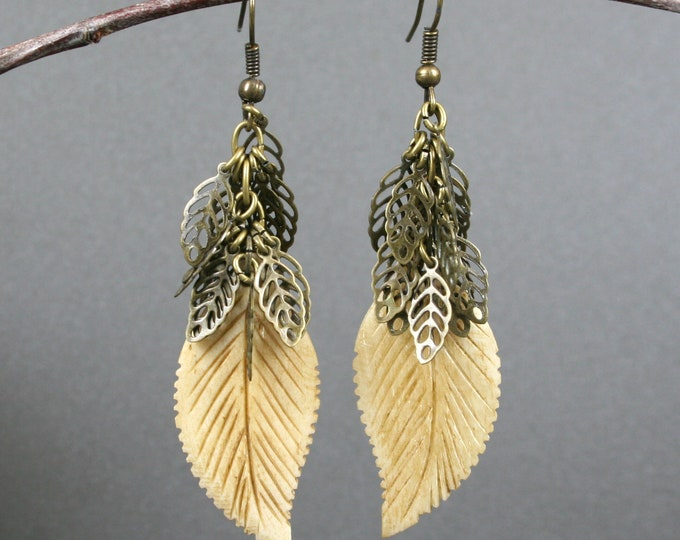 Bone leaf earrings on bronze ear wires with antiqued brass leaves