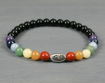 Rainbow stone and obsidian stretch bracelet with an antiqued rhodium plated LOVE bead