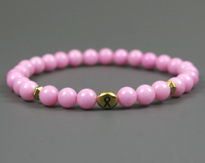 Pink dolomite stretch bracelet with antiqued gold plated pewter breast cancer awareness ribbon bead and spacers