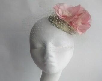 Spring flower fascinator with birdcage veil