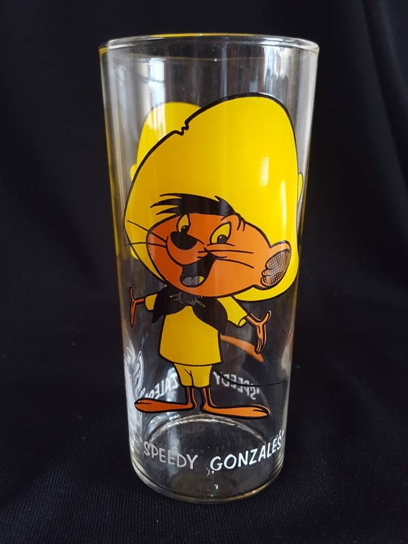 original thin glassware with white lettering. Set of 2 Warner Brothers Sylvester and Speedy Gonzales Tumblers