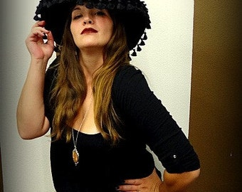 Elegant Black Witch hat with ruched crown and tassels