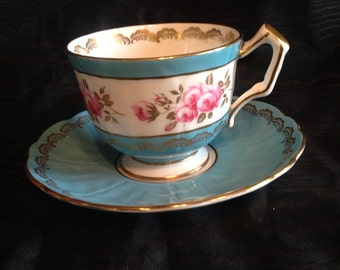 Aynsley turquoise tea cup and saucer