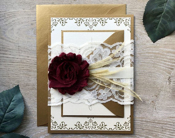 JENNIFER - Burgundy and Gold Lace Wedding Invitation - Lace Belly Band - Ivory Lace Wrap with Maroon Chiffon Flower and Gold Feathers