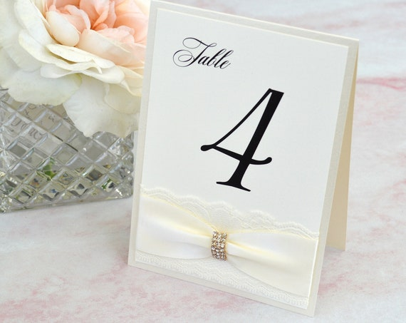 Tented Table Number for Weddings - Ivory Tented Table Card with Ivory Lace, Ribbon and Gold Rhinestone Buckle