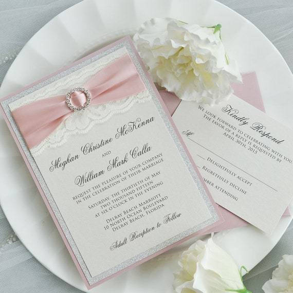 MEGHAN - Ivory Lace Wedding Invitation with Silver Glitter, Blush Pink Satin Ribbon, and Silver Rhinestone Buckle