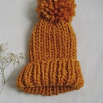 Handmade woolen pom pom hat - terracotta