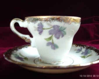 Vintage Tea Cup and Saucer White with Purple flowers and trimmed in Gold