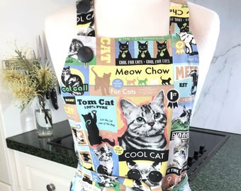 Cat apron. Women's or man's, adjustable, handmade pinny in a colourful, feline print, soft cotton duck with pockets. Lady's or man's apron