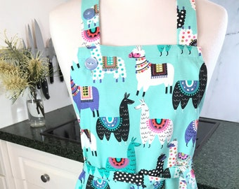 Alpaca apron. Handmade, adjustable, woman's or man's apron in a colourful, alpaca or llama pattern, cotton with large pockets. Lady's pinny