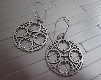 Large metal gear earrings and handmade ear wires.