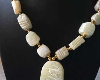 Unique  white carved stone necklace with center hanging pendant