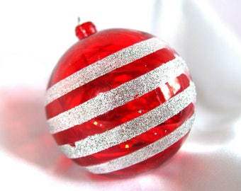 large plastic ornament vintage round red ornament with silver glitter stripes and tinsel