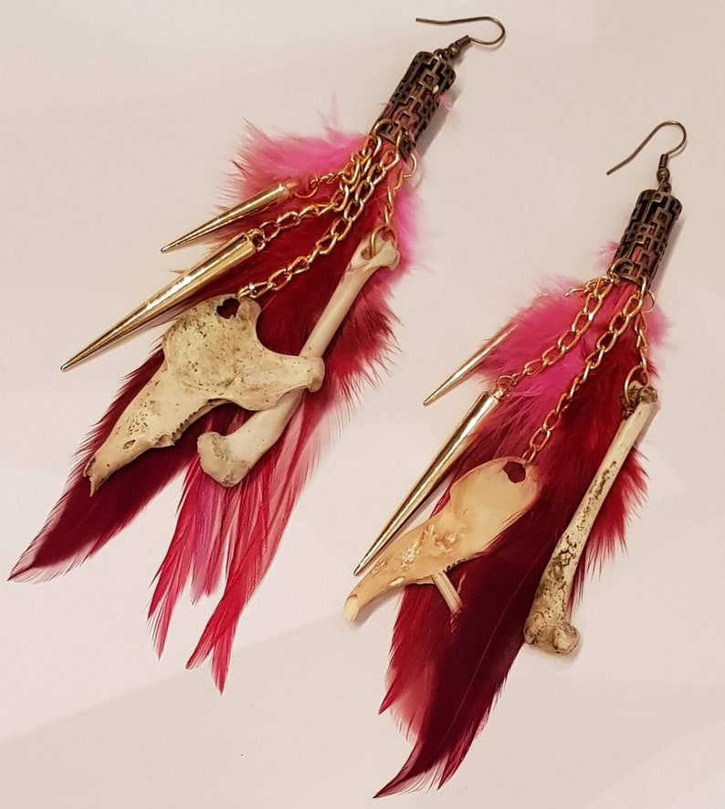 gold chained spikes long earrings Red and fushia feathers with rabbit bones