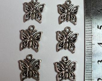 Six little butterflies chiseled