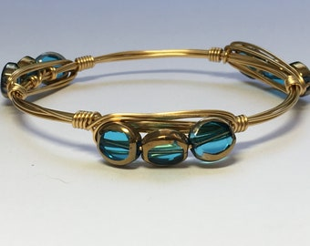 Turquoise/gold wire wrapped bracelet