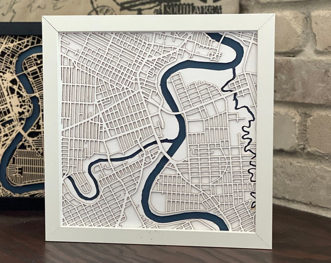 "Winnipeg Manitoba Minimal White and Blue Matboard 3D Laser Cut Map | Wall Art | 10""x 10"" Black Frame w/Hook 