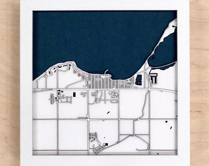 "Gimli Manitoba Minimal White & Blue 3D Laser Cut Map | Wall Art | 10""x 10"" White Frame w/Hook | Home and Office Decor | Lake Winnipeg Map"