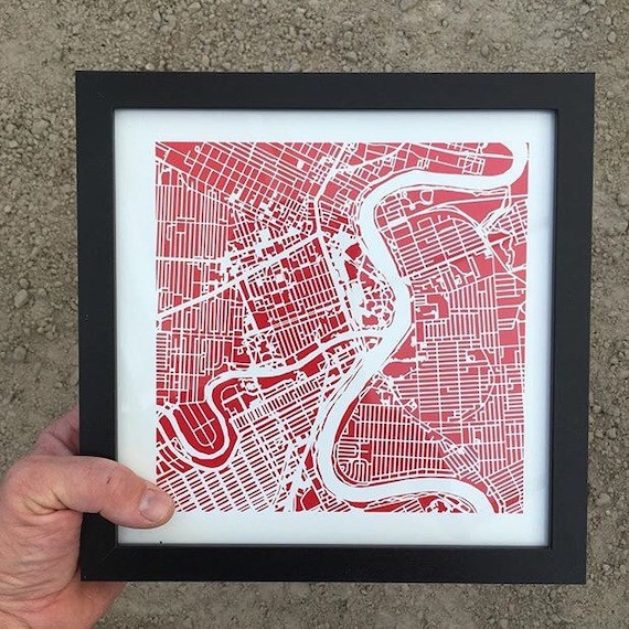 "Winnipeg maps print, 10""x 10"" comes framed. Red in colour"