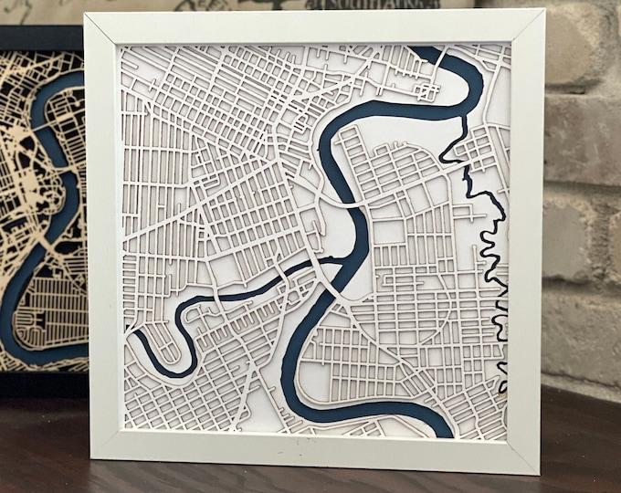 "Winnipeg Manitoba Minimal White and Blue Matboard 3D Laser Cut Map | Wall Art | 10""x 10"" Black Frame w/Hook | Home & Office Decor"