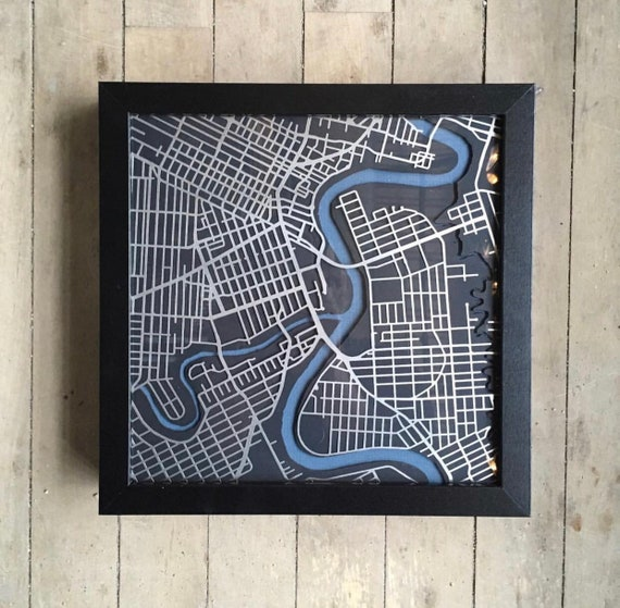 "City of winnipeg map art.  These maps are laser cut from stainless steel and come framed. Made in Winnipeg Manitoba. 9""x9"""