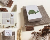 GAMES CARD SET with animal illustrations. Recommended games include snap, pairs & happy families