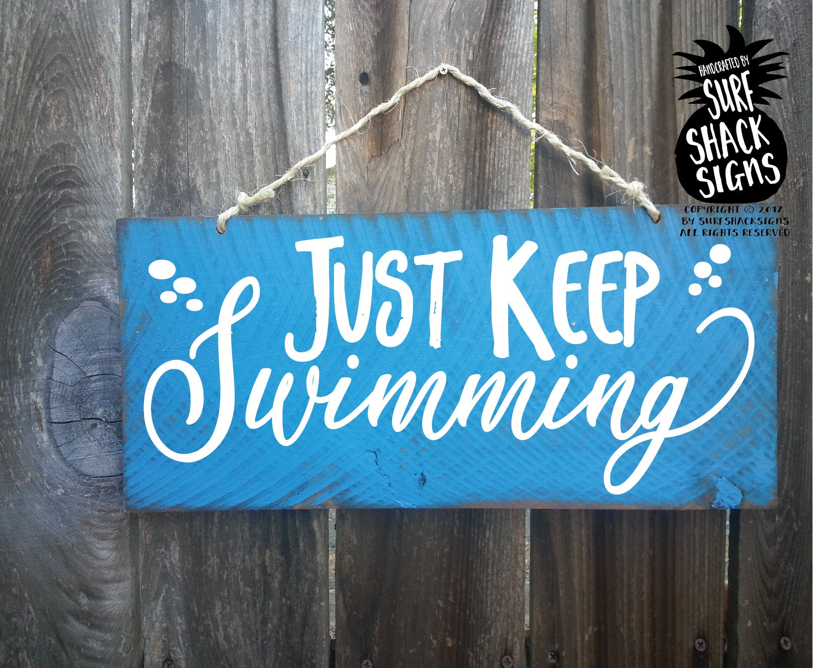 just keep swimming sign