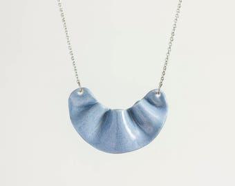 Light blue ceramic necklace.