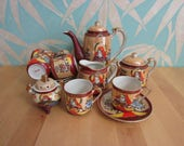 Delicate vintage hand-painted Japanese Samurai tea set with koro